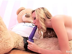 Brett Rossi plays with a inserted bear's strap-on faux-cock