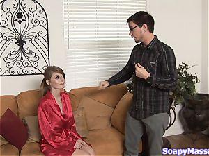Smoking sizzling redhead Faye Reagan gives a soapy massage