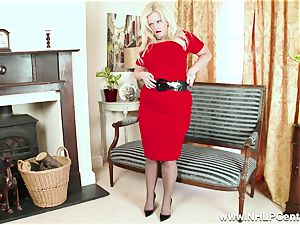 curvaceous blonde masturbates in grey nylons and high heels